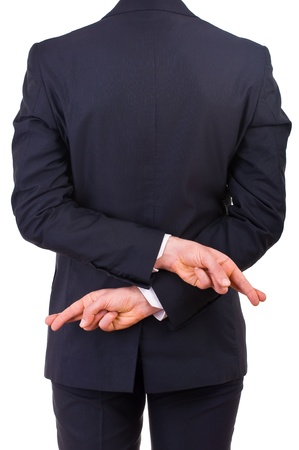 Business man with fingers crossed  photo