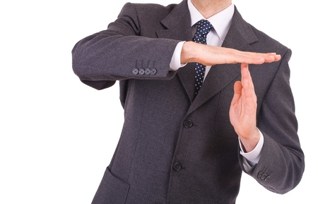 Businessman showing time out sign with hands  photo