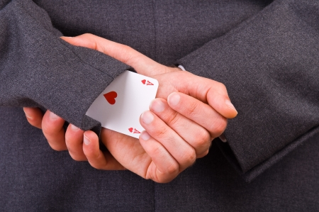 Businessman with ace card hidden under sleeve  photo