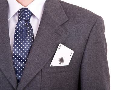 Businessman with playing card in his pocket  photo