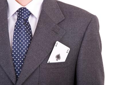 Hombre de negocios con la tarjeta que juega en el bolsillo photo