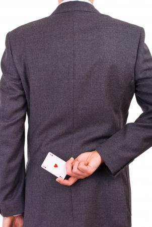 Holding de negocios que juega la tarjeta a la espalda photo