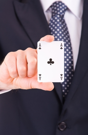 Businessman showing playing card Stock Photo - 19643761