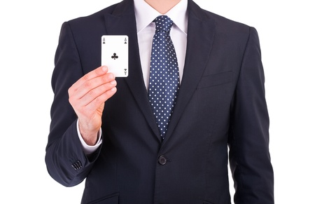 Businessman showing playing card  photo