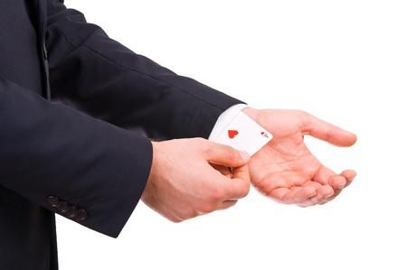 Businessman with ace card hidden under sleeve