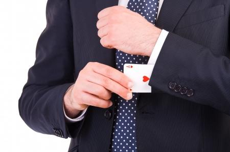 Uomo d'affari con carta di asso nascosto sotto manica