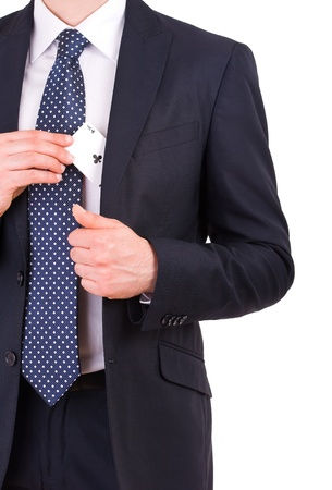 Businessman putting ace card in his pocket  photo