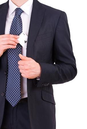 Empresario poner tarjeta del as en el bolsillo photo