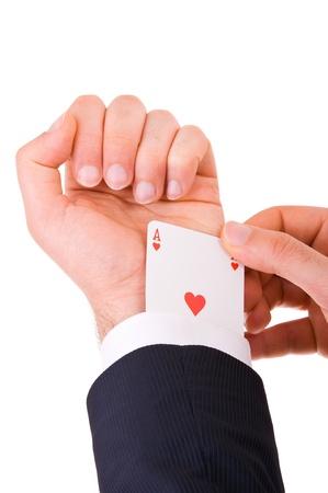 Businessman with ace card hidden under sleeve  photo