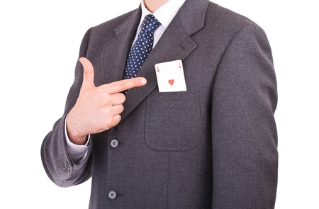 Businessman indicating ace card in his pocket. photo