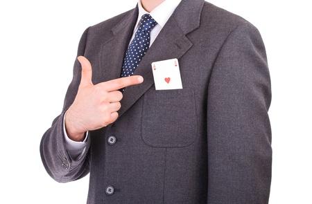 Empresario indicando tarjeta del as en el bolsillo. photo