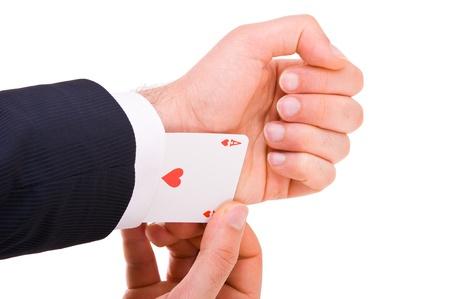 Hombre de negocios con tarjeta del as escondido bajo la manga. photo