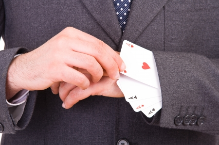 Businessman with playing cards hidden under sleeve. photo