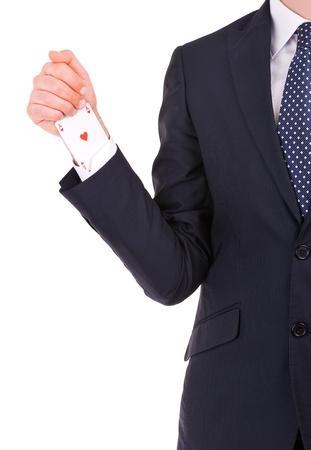 Businessman with ace card hidden under sleeve. photo