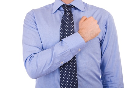 pledge: Businessman taking oath with fist over heart  Stock Photo