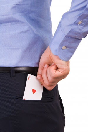 Businessman putting ace card in back pocket  photo