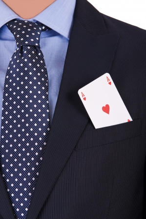 Businessman with playing card in his pocket. photo