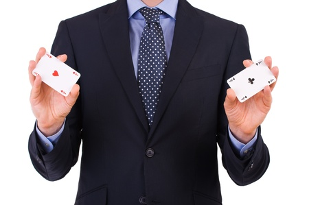 Businessman showing playing cards. photo