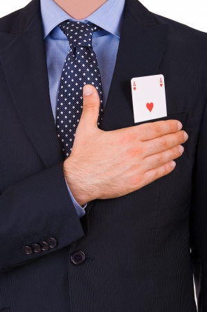 Businessman taking oath with ace card in pocket. Stock Photo