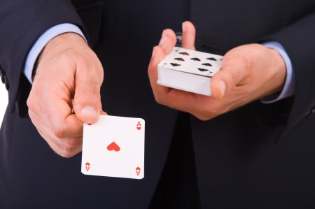 Businessman showing playing cards.