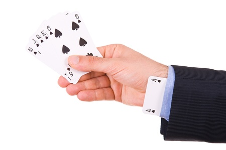 Businessman with ace card hidden under sleeve. photo