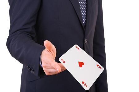jeu de carte: Homme d'affaires projetant cartes à jouer Banque d'images