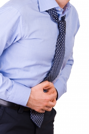 achy: Businessman suffering from stomach pain. Stock Photo