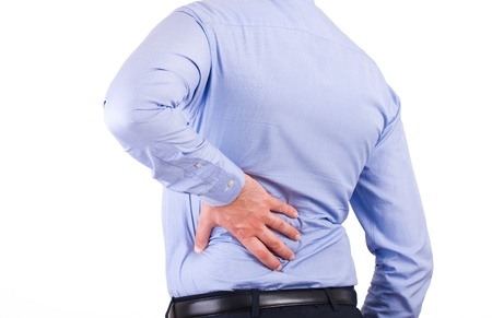 backpain: Businessman with aching back.