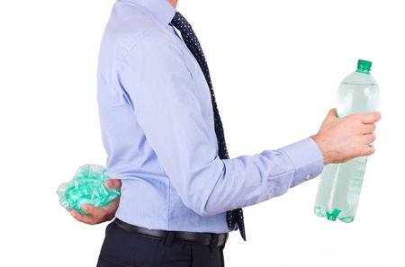 Businessman holding green bottles. photo