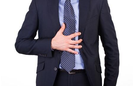 Uomo d'affari che soffrono di bruciore di stomaco.