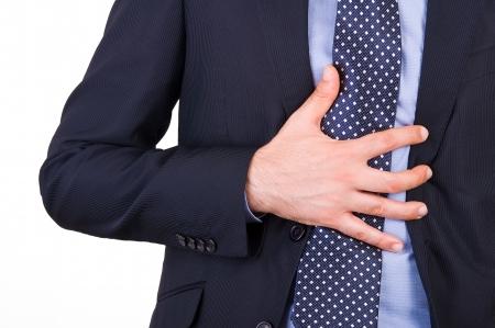 gastritis: Businessman suffering from heartburn.