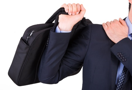 Businessman suffering from shoulder pain. photo