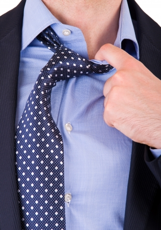 Businessman pulling his collar  photo