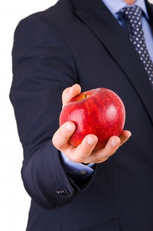Businessman holding a red apple. photo