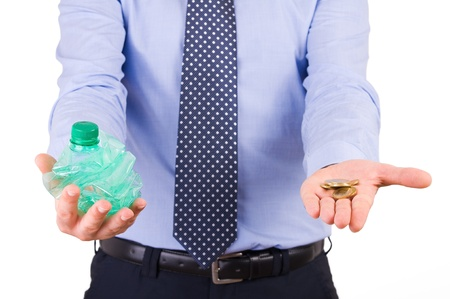 Businessman holding crushed bottle and coins. photo