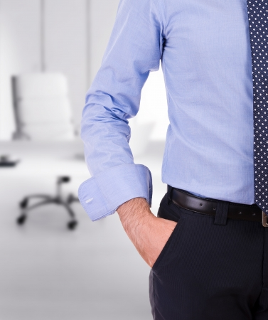 Businessman with hand in pocket. photo