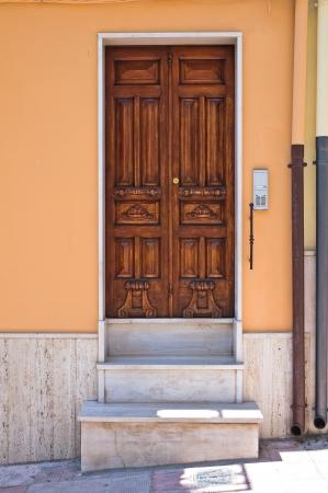 daunia: Wooden door. Biccari. Puglia. Italy.