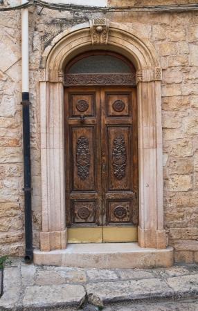 conversano: Wooden door. Conversano. Puglia. Italy.  Stock Photo
