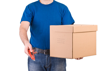 shipper: Delivery man hold a box and offer a cutter