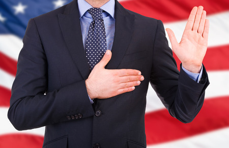 oath: Businessman taking oath. Stock Photo