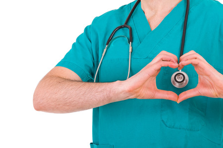Medical doctor showing heart sign photo