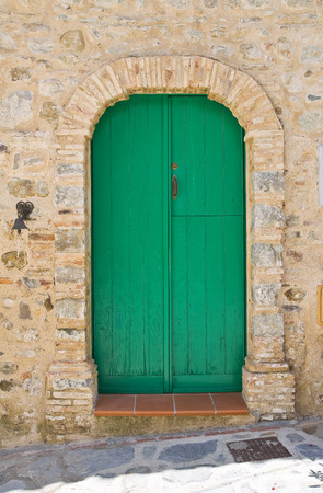 urbanistic: Wooden door. Rocca Imperiale. Calabria. Italy. Stock Photo