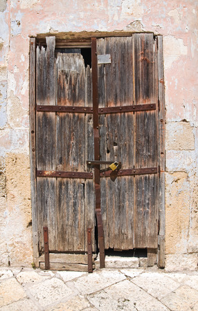 view of a wooden doorway: Wooden door. Altamura. Puglia. Italy. Stock Photo