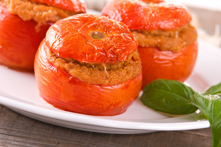 alimentation: Stuffed tomatoes on white plate Stock Photo