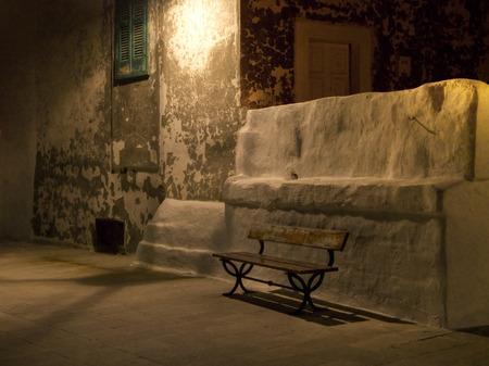 monopolies: Garden seat by night.