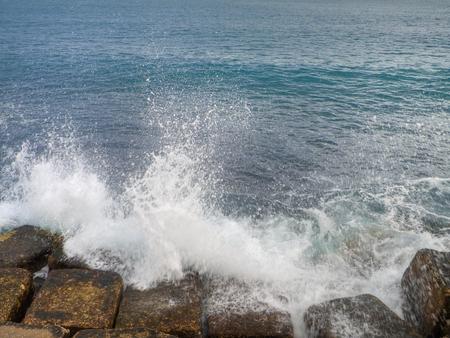 monopolies: Waves smash against sea rocks.