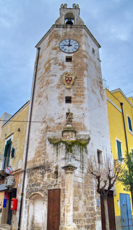dinnertime: This is the old clock tower of Monopoli. Apulia. Stock Photo