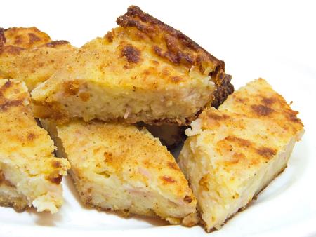 gateau: This is a potatoes gateau sliced on a dish.