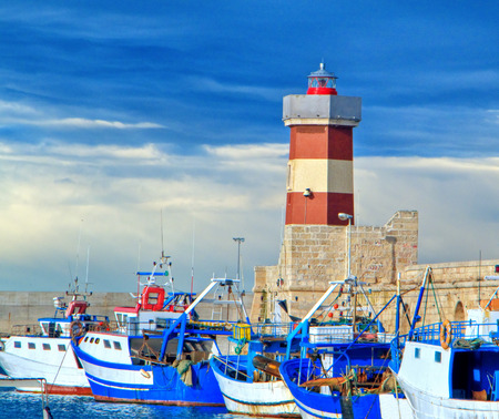 This is a landscape view of old touristic port of Monopoli in Apulia.