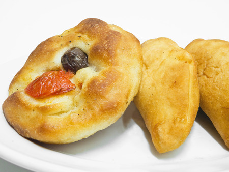 speciality: These are a typical Italian speciality called focaccia and panzerotti. Stock Photo